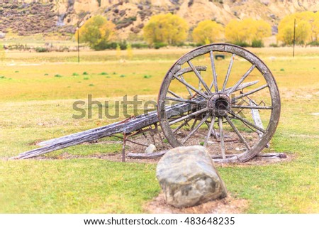 old wooden wagon wheel-autumn background-selective focus