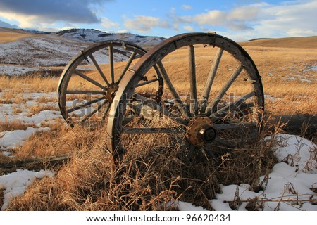 Old wooden wagon wheels in the country; Porcupine Hills, southern Alberta, Canada - stock photo