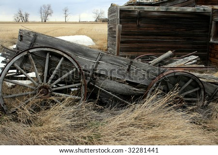 Old wooden wagon with wagon wheel...abandoned - stock photo