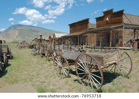 Old Wooden Wagons in a Ghost Town - stock photo