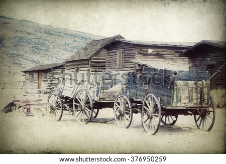 Old Wooden Wagons in a Ghost Town, Cody, Wyoming, (my own artistic version) - stock photo