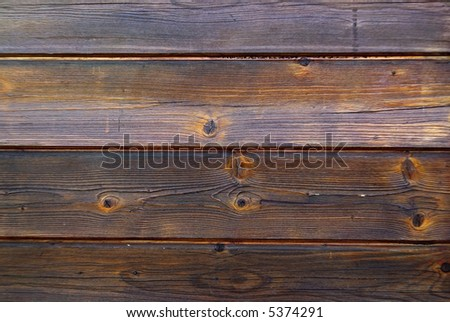 Old Wooden wall with dark brown planks. - stock photo