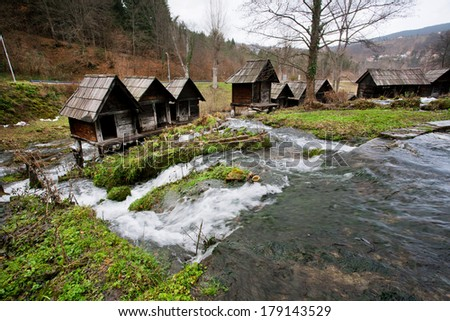 Old wooden water mills built on a fast flowing river canal in the popular ancient village near city Jajce in Bosnia and Herzegovina.
