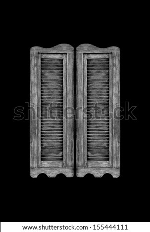 Old wooden western swinging saloon doors isolated on black background. - stock photo