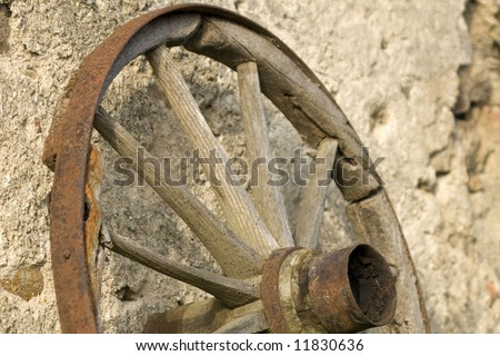 Old wooden wheel. - stock photo