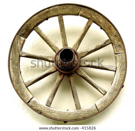 Old wooden wheel. (For more artistic photos, please visit my gallery!Thank you!) - stock photo