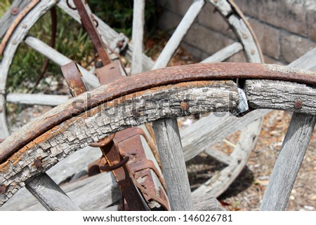 Old Wooden Wheel Near Santa Barbara, California - stock photo