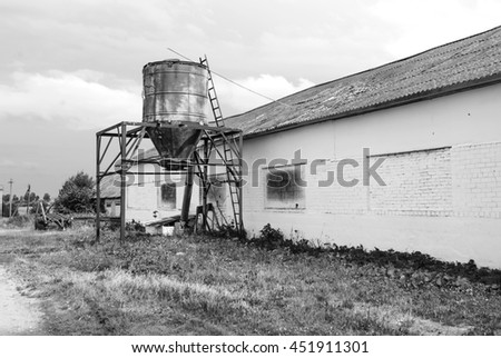 Old wooden white barn. Black and White Background. - stock photo