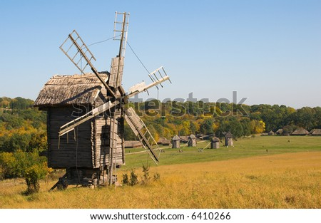 Old wooden windmill in autumn's environment