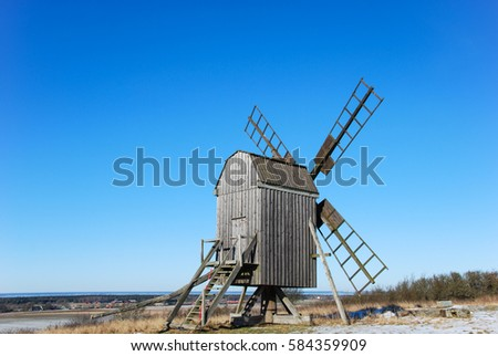 Old wooden windmill on a hill at the swedish island Oland, the island of sun and wind in the Baltic Sea. Windmills are typical symbols for the island Oland.
