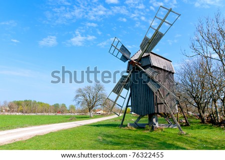 Old wooden windmill on the island Oeland, Sweden, near the town Borgholm. - stock photo
