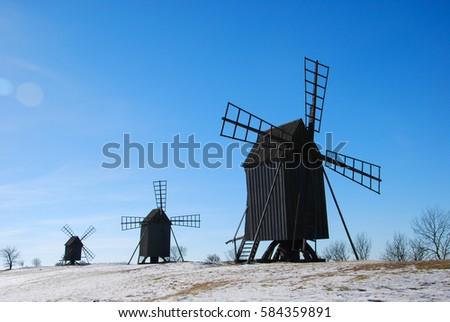 Old wooden windmills in a row at the swedish island Oland. Windmill are iconic symbols for the island Oland, the island of sun and wind