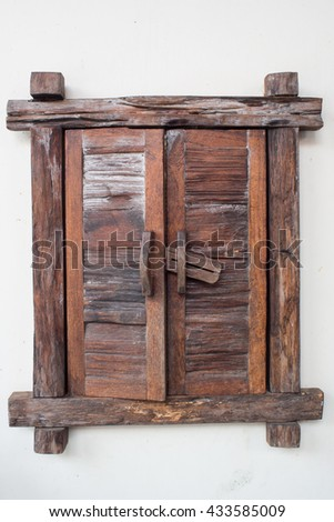 old wooden window on the white wall