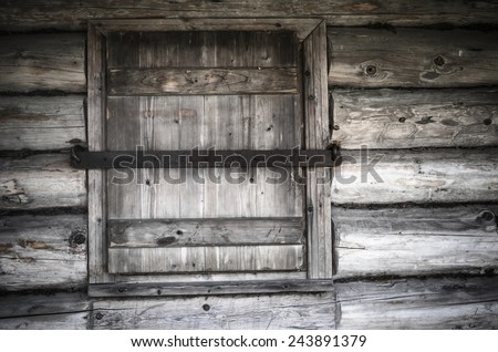 Old wooden window shutters closed, close-up - stock photo