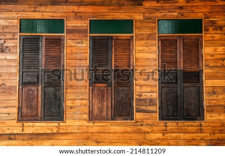 old wooden window with green stained glass - stock photo