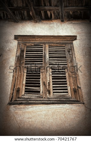 Old wooden window with shutters in Greece. - stock photo
