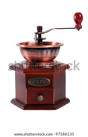 old wooden worm eaten coffee mill isolated on a white background - stock photo