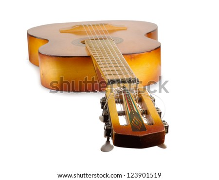 Old wooden yellow acoustic guitar isolated on white background - stock photo