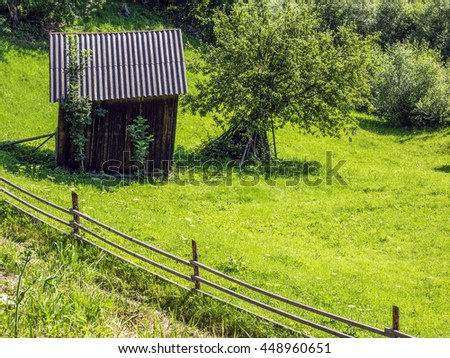 Old woodshed in the high mountains - stock photo