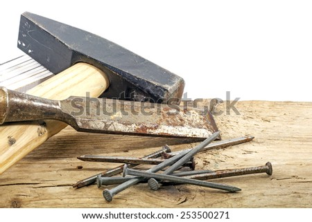 old woodworker tools and nails on rustic wood, copy space in the white background - stock photo