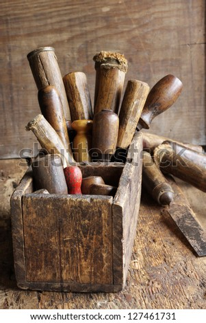 Old woodworking tools in a wooden box at workbench. - stock photo