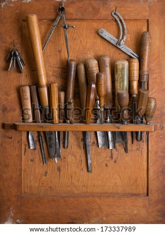 Old woodworking tools in carpentry shelf. Close up. - stock photo