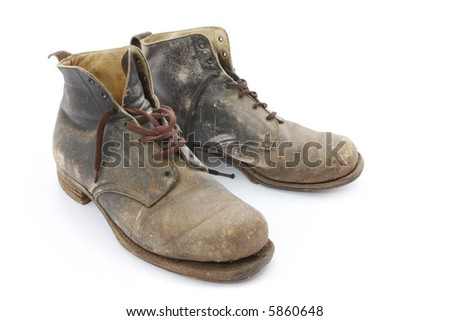 Old work boots, 1940's vintage and worn until recent years. - stock photo