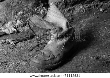 Old working boot (black and white photo)