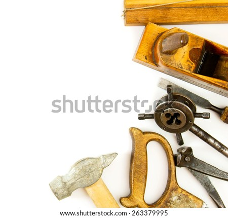 Old working tools. Vintage working tools ( hammer, saw and others) on white background. - stock photo