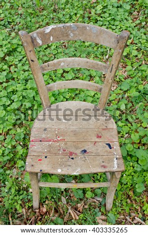 Old Workshop Wooden Empty Chair on the Grass - stock photo