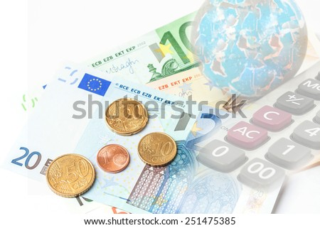old world globe ,money, calculator on white background. abstract background to solution of import,export,and on line international commercial. - stock photo