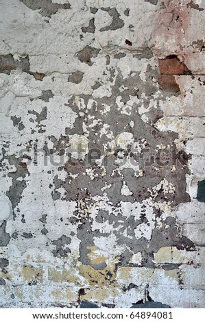 Old worn and weathered chipped paint on a cement wall texture. - stock photo