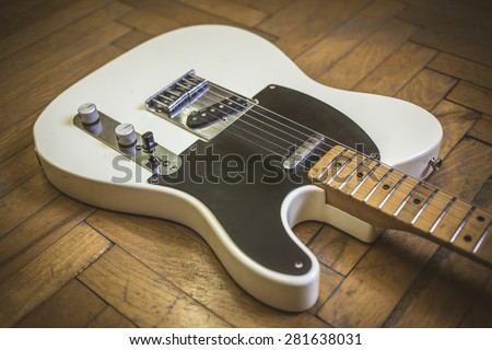 Old worn electric guitar - stock photo