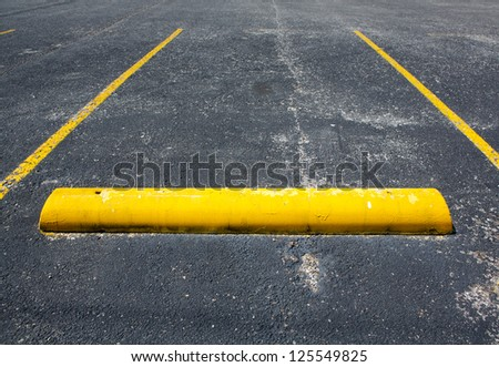 Old Worn Empty Parking Space with room for copy - stock photo