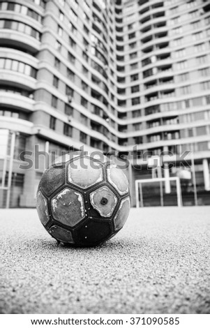 Old worn leather ball  on a playground  - stock photo