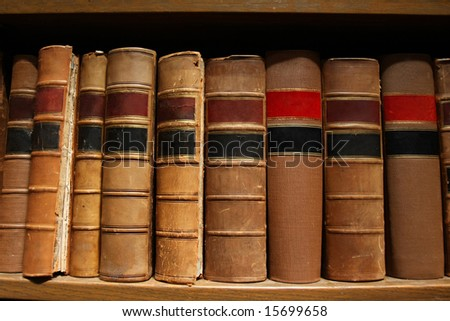 Old worn out books on a shelf. - stock photo