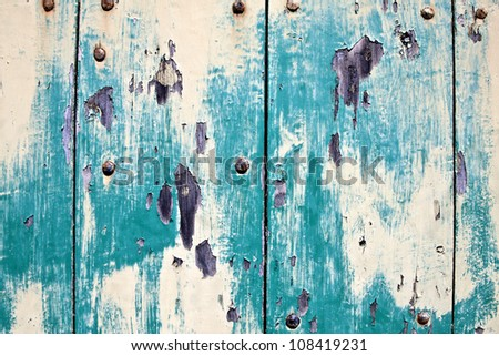 old worn painted wood texture with nails - stock photo