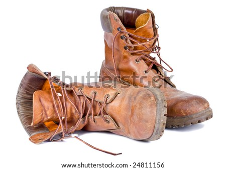 Old worn pair of leather walking boots - stock photo