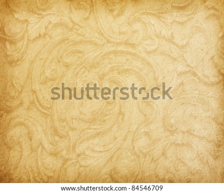 Old worn paper with floral ornament - stock photo