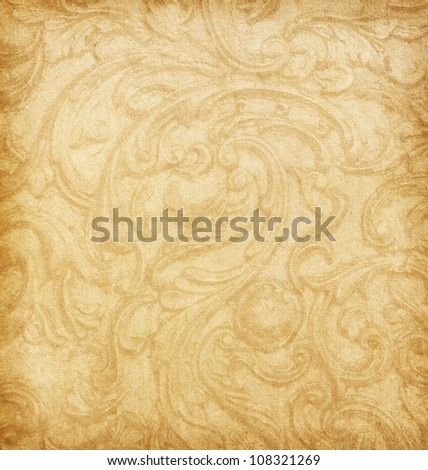Old worn paper with floral ornament. Beige background. - stock photo