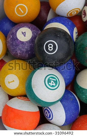old worn pool balls in a random pile