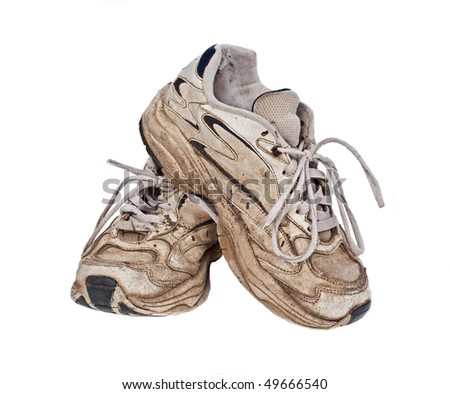 Old, worn sneakers on white background