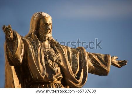 Old, worn statue of Jesus Christ - stock photo