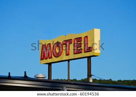Old Worn Vintage Motel Sign - stock photo