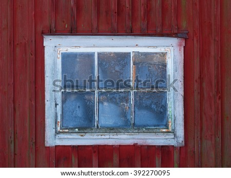 Old worn window in a barn,