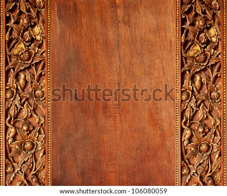 Old worn  wooden board with oriental ornament. - stock photo
