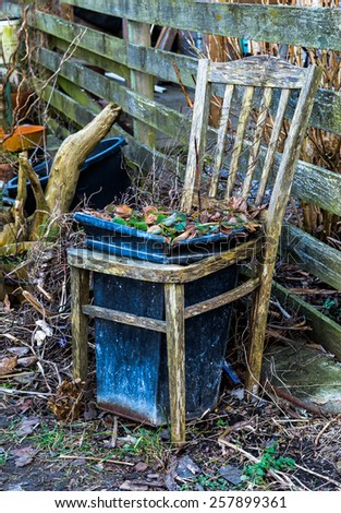 Old worn wooden chair - stock photo