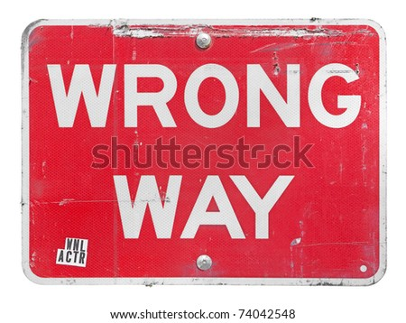 Old worn wrong-way sign with clipping path - stock photo
