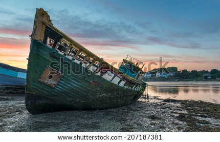 Old wreck on the shore - stock photo