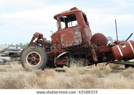 Old wrecked and rusted truck on a scrapyard - stock photo
